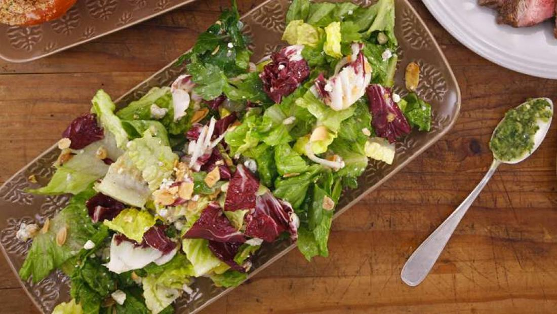 Salad with toasted almonds honey dijon vinaigrette and crumbled