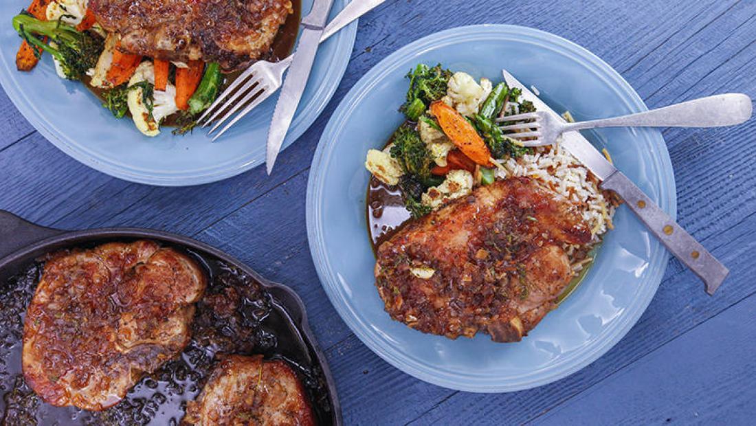 Orange Glazed Pork Chops Roasted Vegetable Medley And Almond Rice