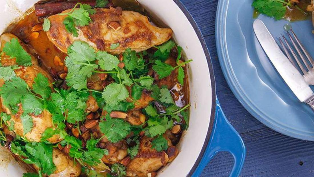 One pot spiced chicken and coconut with raisins and almonds