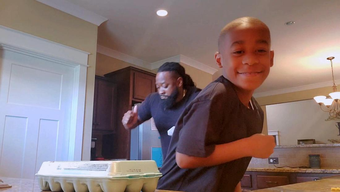 Marcus and MJ dancing in the kitchen
