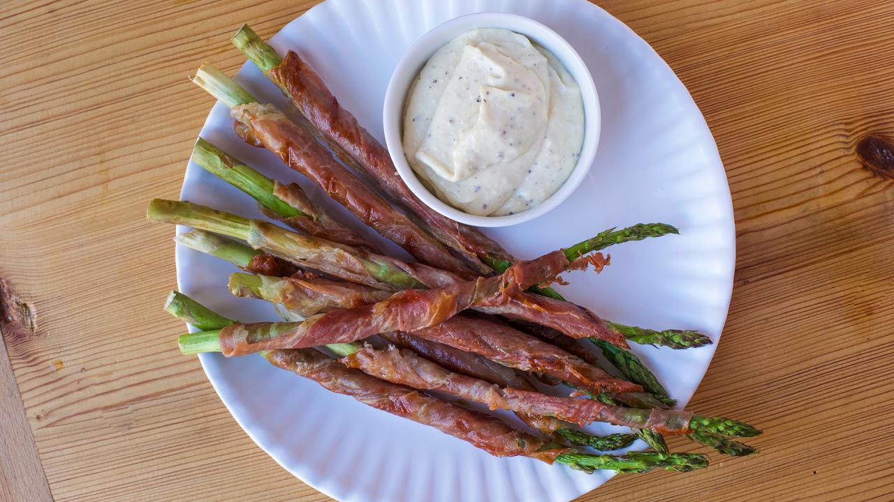 Prosciutto-Wrapped Asparagus On The Grill With Lemony Parmesan Dipping Sauce