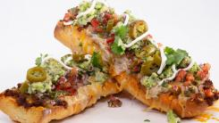 Rach's Nacho French Bread Pizza Swaps Out Chips For a Crust