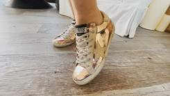 Gretta wearing Golden Goose sneakers