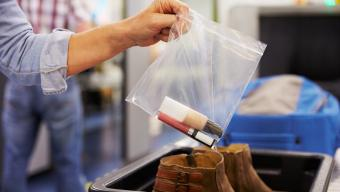 woman's hand holding plastic bag with liquids at airport security