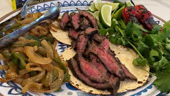 Charred Carne Asada Tacos with Roasted Poblanos + Avocado Crema