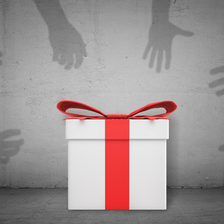 gift with hands reaching for it