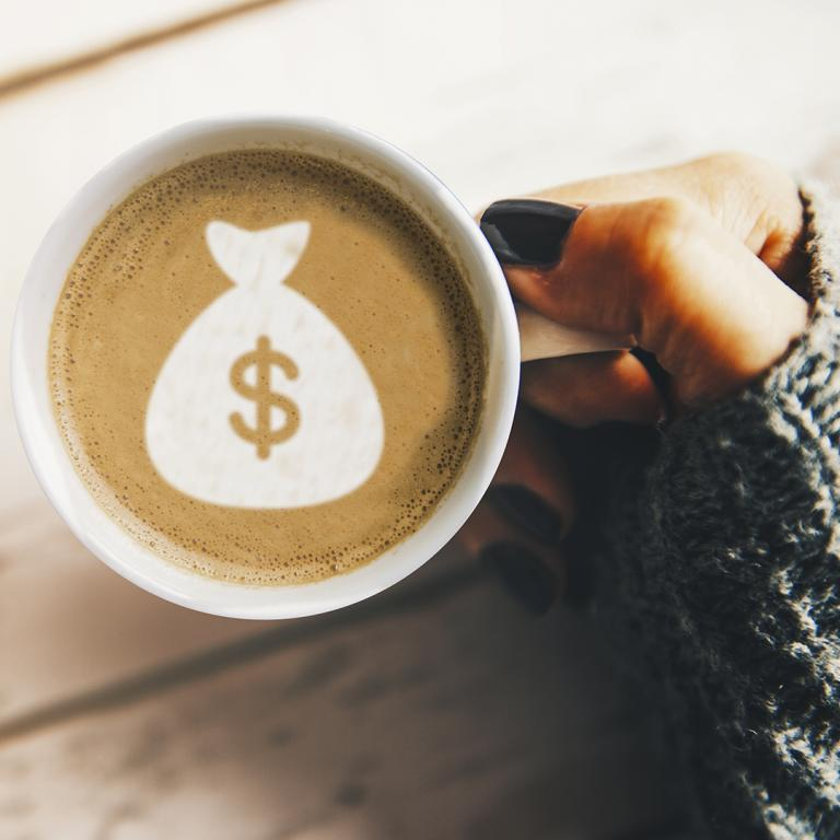 cup of coffee with money in foam