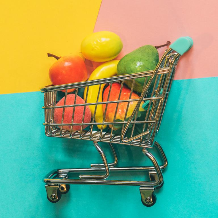 grocery cart filled with fruit
