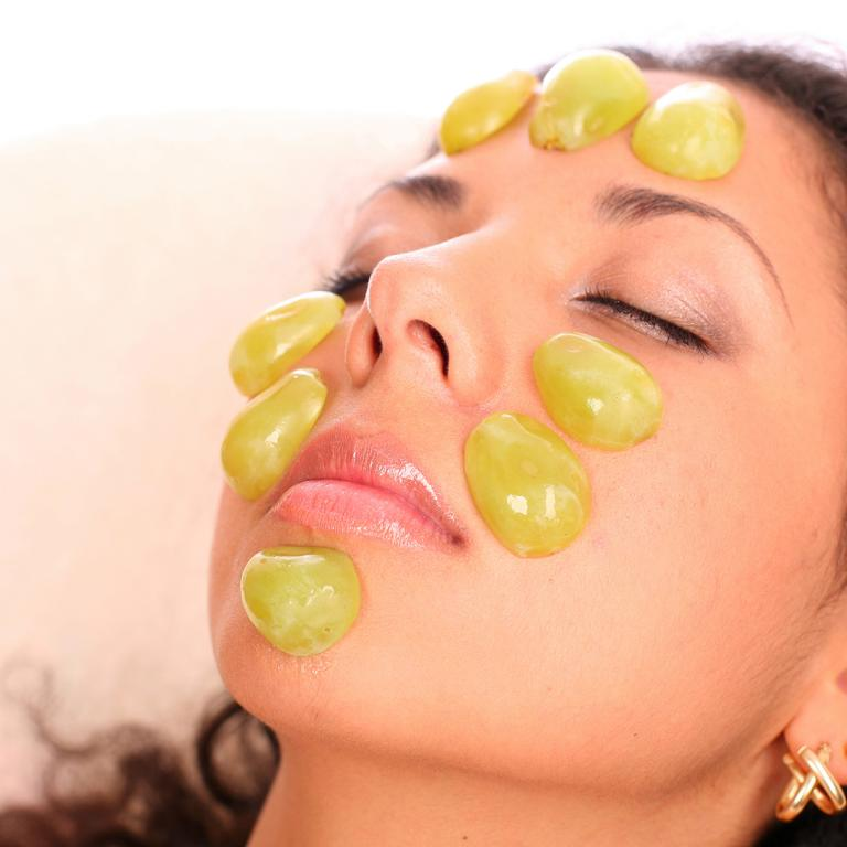 grapes on face