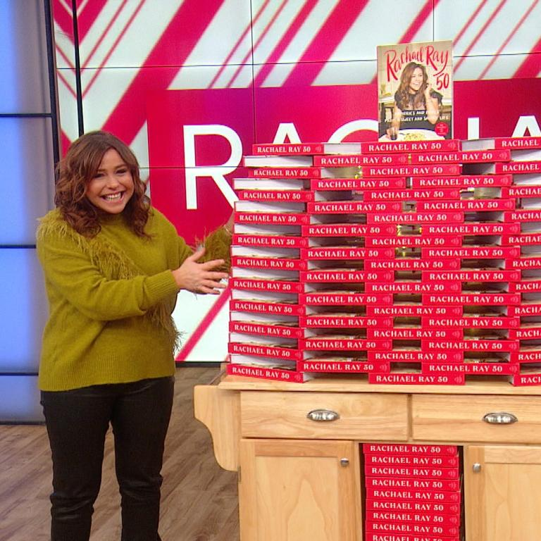 Rachael Ray with copies of her cookbook