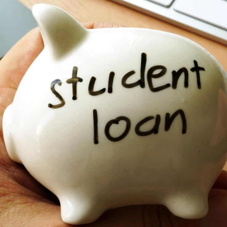 "piggy bank with ""student loan"" written on it"
