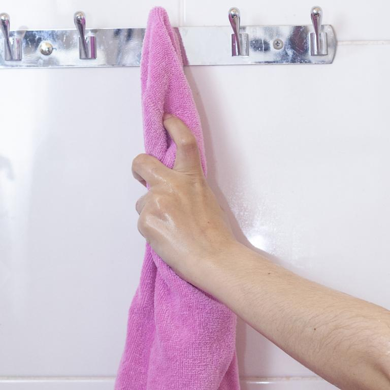 woman's hand reaching for a towel
