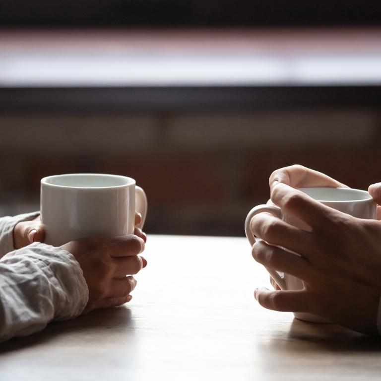Stock Couple Talking Over Coffee