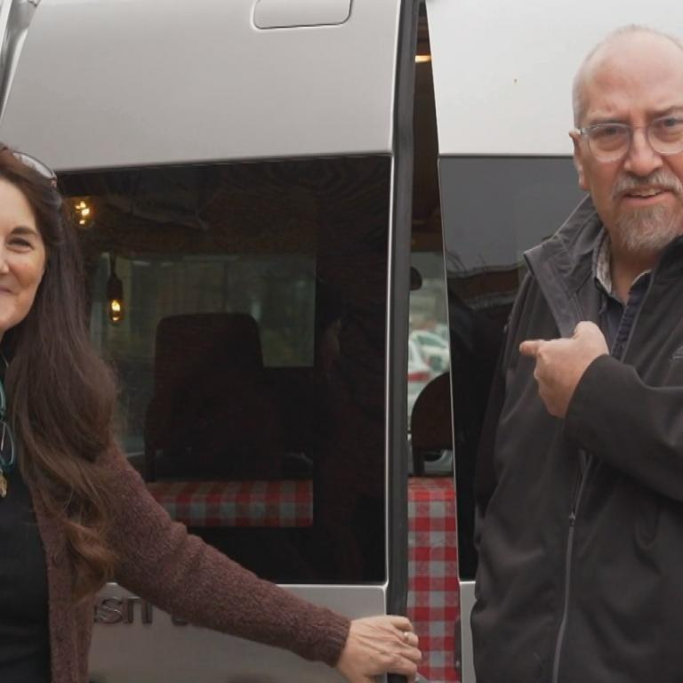 viewer couple with van