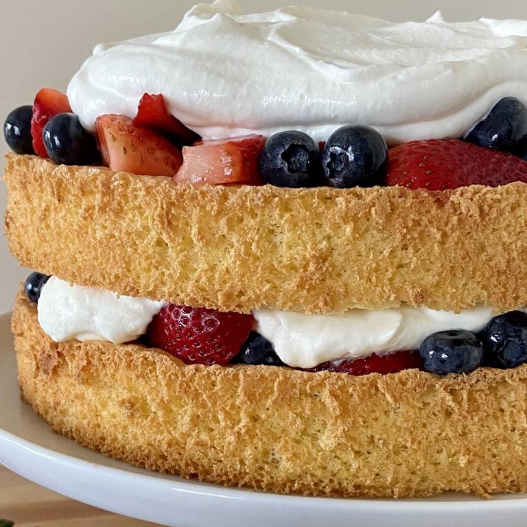 sponge cake with berries and whipped cream