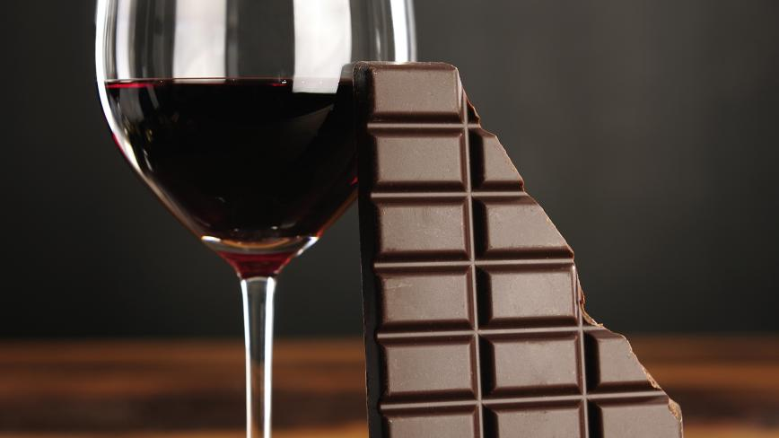 glass of red wine and dark chocolate bar