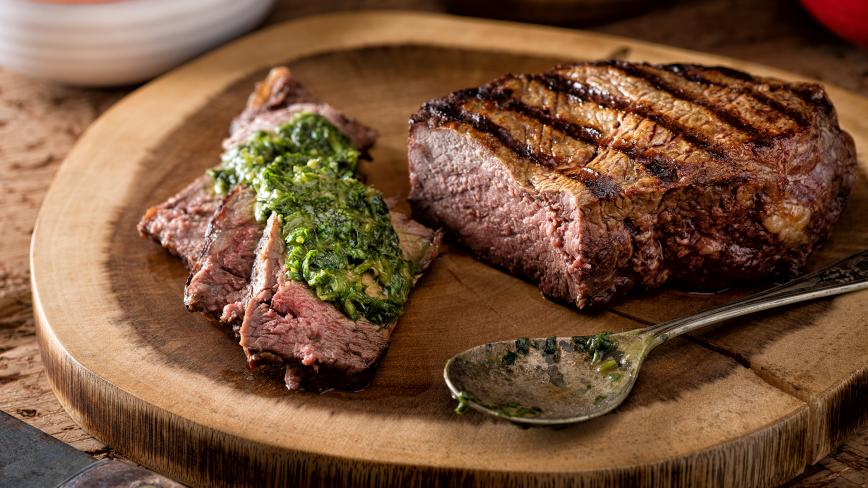 chimichurri sauce on meat