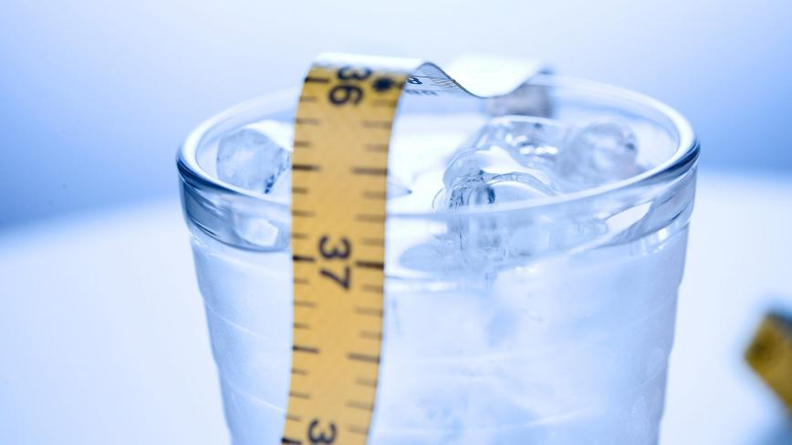glass of water with measuring tape