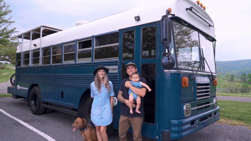 family in front of converted school bus tiny home