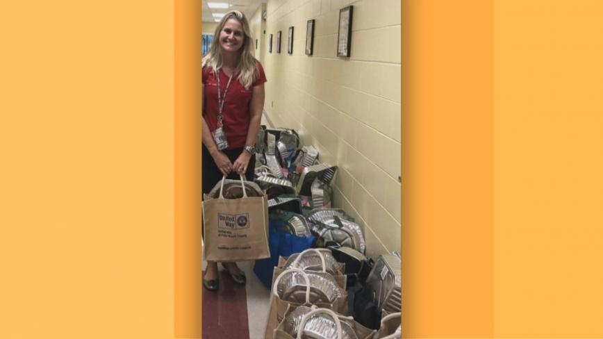 Rebecca with food donations
