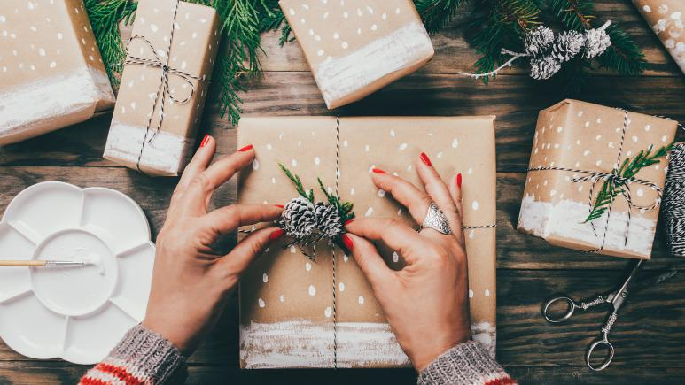 Woman's hands wrapping holiday gift