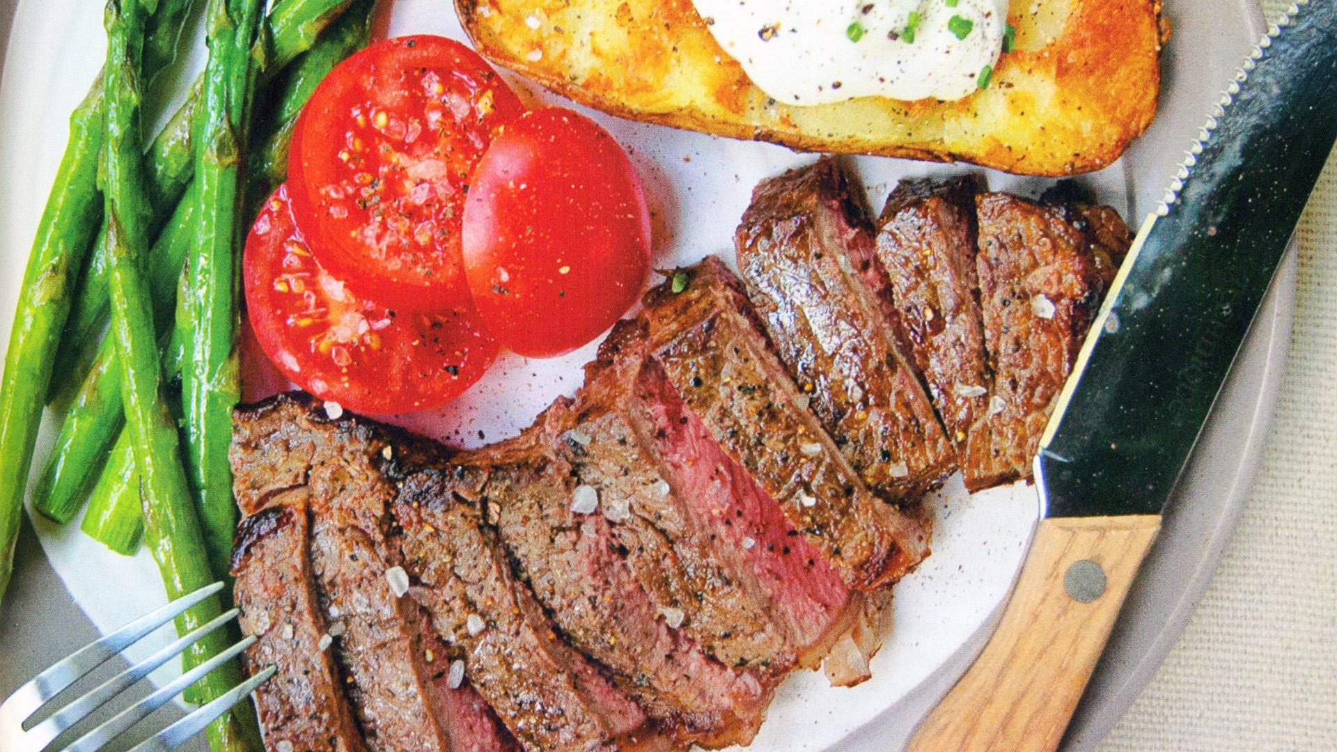 New York Strip Steak with Baked Potatoes and Asparagus